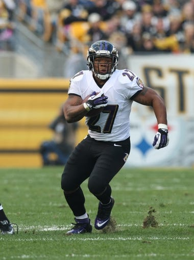 Oct 20, 2013; Pittsburgh, PA, USA; Baltimore Ravens running back Ray Rice (27) runs the ball against the Pittsburgh Steelers during the first half at Heinz Field. Mandatory Credit: Jason Bridge-USA TODAY Sports