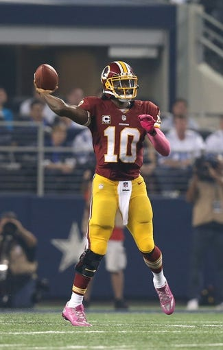 Oct 13, 2013; Arlington, TX, USA; Washington Redskins quarterback Robert Griffin III (10) throws against the Dallas Cowboys at AT&T Stadium. Mandatory Credit: Matthew Emmons-USA TODAY Sports