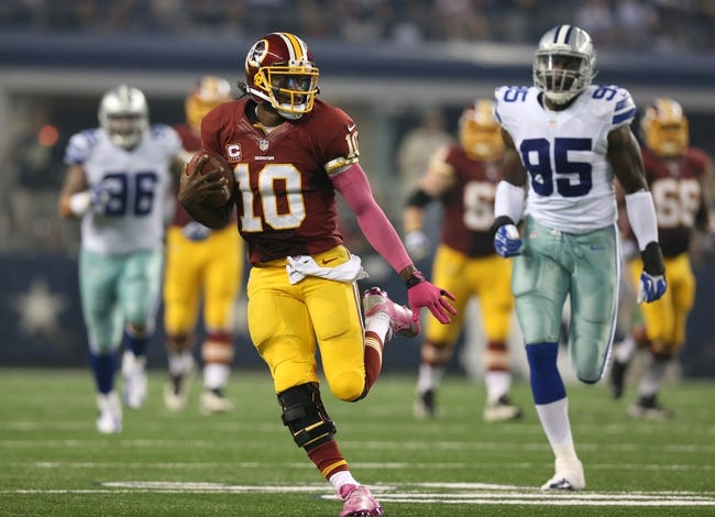 Oct 13, 2013; Arlington, TX, USA; Washington Redskins quarterback Robert Griffin III (10) runs with the ball against the Dallas Cowboys at AT&T Stadium. Mandatory Credit: Matthew Emmons-USA TODAY Sports