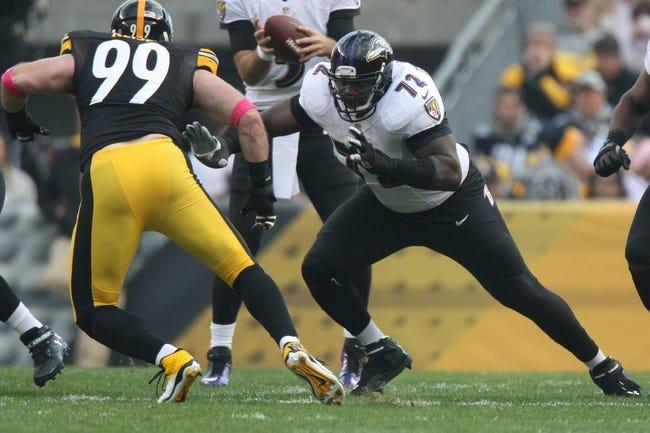 Oct 20, 2013; Pittsburgh, PA, USA; Baltimore Ravens guard Kelechi Osemele (72) blocks Pittsburgh Steelers defensive end Brett Keisel (99) during the first half at Heinz Field. Mandatory Credit: Jason Bridge-USA TODAY Sports