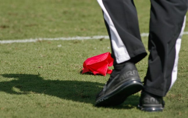 Sep 29, 2013; Jacksonville, FL, USA; A referee walks towards a challenge flag, thrown by the Jacksonville Jaguars, in the second quarter of their game against the Indianapolis Colts at EverBank Field. The Indianapolis Colts beat the Jacksonville Jaguars 37-3. Mandatory Credit: Phil Sears-USA TODAY Sports