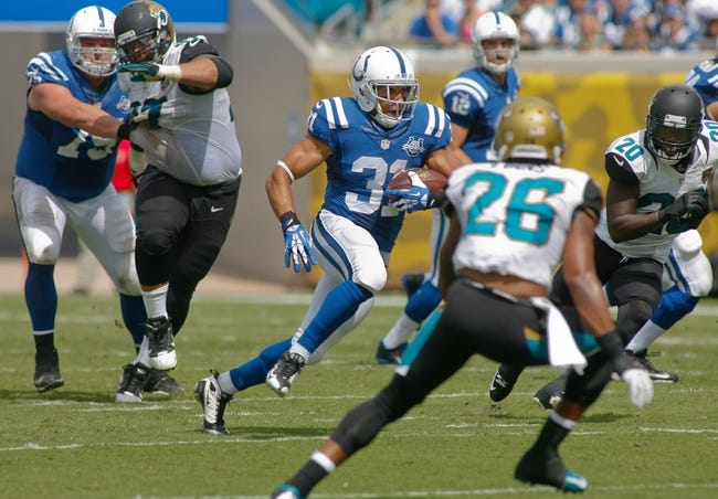 Sep 29, 2013; Jacksonville, FL, USA; Indianapolis Colts running back Donald Brown (31) runs for a 50-yard run as he is pursued by Jacksonville Jaguars cornerback Mike Harris (20) in the second quarter of their game at EverBank Field. The Indianapolis Colts beat the Jacksonville Jaguars 37-3. Mandatory Credit: Phil Sears-USA TODAY Sports
