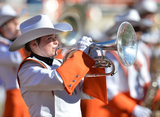 Oct 19, 2013; Stillwater, OK, USA; A member of the Oklahoma State Cowboys band performs before a game against the Texas Christian Horned Frogs at Boone Pickens Stadium. Mandatory Credit: Peter G. Aiken-USA TODAY Sports