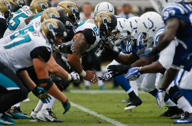 Sep 29, 2013; Jacksonville, FL, USA; Jacksonville Jaguars center Brad Meester (63) at the line of scrimmage against the Indianapolis Colts in the second quarter of their game at EverBank Field. The Indianapolis Colts beat the Jacksonville Jaguars 37-3. Mandatory Credit: Phil Sears-USA TODAY Sports