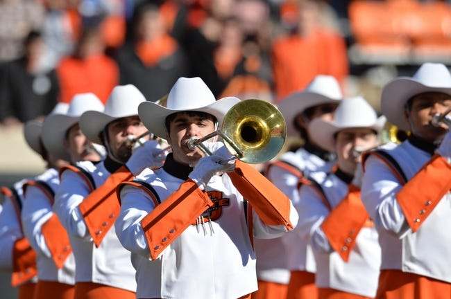 Oct 19, 2013; Stillwater, OK, USA; Members of the Oklahoma State Cowboys band perform before a game against the Texas Christian Horned Frogs at Boone Pickens Stadium. Mandatory Credit: Peter G. Aiken-USA TODAY Sports