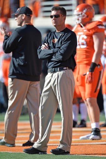 Oct 19, 2013; Stillwater, OK, USA; Oklahoma State Cowboys head coach Mike Gundy before a game against the Texas Christian Horned Frogs at Boone Pickens Stadium. Mandatory Credit: Peter G. Aiken-USA TODAY Sports