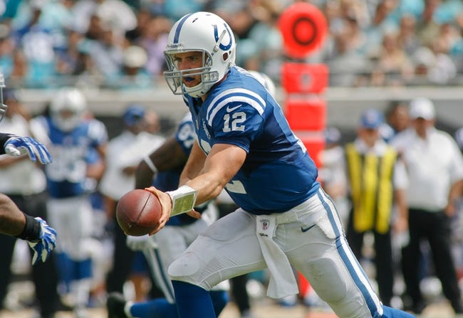 Sep 29, 2013; Jacksonville, FL, USA; Indianapolis Colts quarterback Andrew Luck (12) hands off the ball in the second quarter of their game against the Jacksonville Jaguars at EverBank Field. The Indianapolis Colts beat the Jacksonville Jaguars 37-3. Mandatory Credit: Phil Sears-USA TODAY Sports