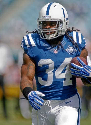 Sep 29, 2013; Jacksonville, FL, USA; Indianapolis Colts running back Trent Richardson (34) runs before the start of their game against the Jacksonville Jaguars at EverBank Field. The Indianapolis Colts beat the Jacksonville Jaguars 37-3. Mandatory Credit: Phil Sears-USA TODAY Sports