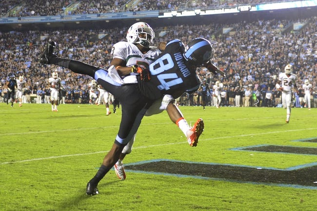 Oct 17, 2013; Chapel Hill, NC, USA; Miami Hurricanes defensive back Tracy Howard (3) is called for pass interference in the end zone as he covers North Carolina Tar Heels wide receiver Bug Howard (84) in the end zone. The Miami Hurricanes defeated the North Carolina Tar Heels 27-23 at Kenan Memorial Stadium. Mandatory Credit: Bob Donnan-USA TODAY Sports