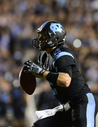 Oct 17, 2013; Chapel Hill, NC, USA; North Carolina Tar Heels quarterback Bryn Renner (2) looks to pass in the fourth quarter. The Miami Hurricanes defeated the North Carolina Tar Heels 27-23 at Kenan Memorial Stadium. Mandatory Credit: Bob Donnan-USA TODAY Sports