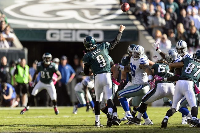 Oct 20, 2013; Philadelphia, PA, USA; Philadelphia Eagles quarterback Nick Foles (9) passes the ball during the third quarter against the Dallas Cowboys at Lincoln Financial Field. The Cowboys defeated the Eagles 17-3. Mandatory Credit: Howard Smith-USA TODAY Sports