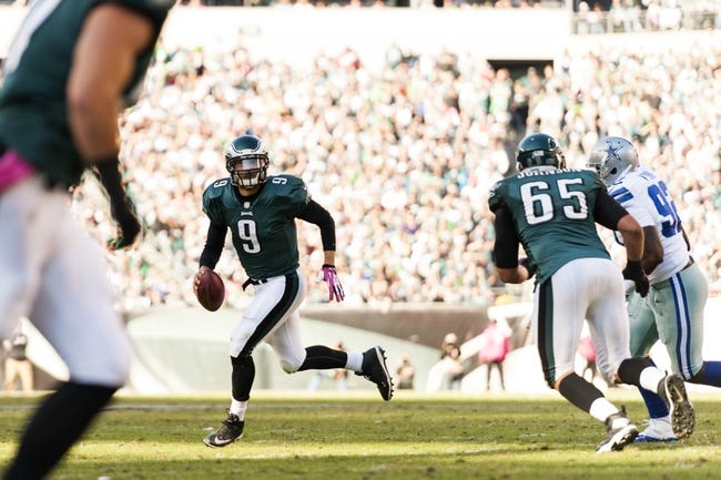 Oct 20, 2013; Philadelphia, PA, USA; Philadelphia Eagles quarterback Nick Foles (9) rolls out during the third quarter against the Dallas Cowboys at Lincoln Financial Field. The Cowboys defeated the Eagles 17-3. Mandatory Credit: Howard Smith-USA TODAY Sports