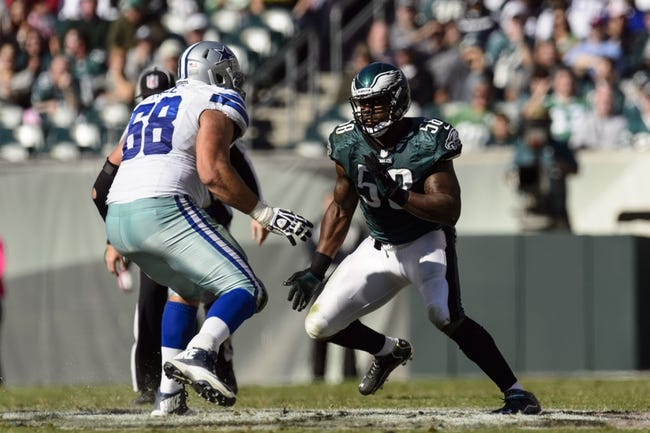 Oct 20, 2013; Philadelphia, PA, USA; Philadelphia Eagles defensive end Trent Cole (58) rushes the passer during the second quarter against the Dallas Cowboys at Lincoln Financial Field. The Cowboys defeated the Eagles 17-3. Mandatory Credit: Howard Smith-USA TODAY Sports