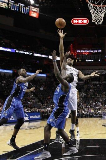 Oct 22, 2013; San Antonio, TX, USA; San Antonio Spurs forward Kawhi Leonard (2) shoots against the Orlando Magic during the first half at AT&T Center. Mandatory Credit: Soobum Im-USA TODAY Sports