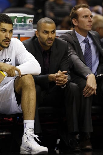 Oct 22, 2013; San Antonio, TX, USA; San Antonio Spurs guard Tony Parker (9) watches from the bench during the second half against the Orlando Magic at AT&T Center. Mandatory Credit: Soobum Im-USA TODAY Sports