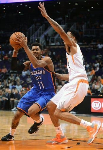 Oct 22, 2013; Phoenix, AZ, USA; Oklahoma City Thunder guard Jeremy Lamb (11) drives the ball against the Phoenix Suns guard Gerald Green (14)in the first half at US Airways Center. Mandatory Credit: Jennifer Stewart-USA TODAY Sports