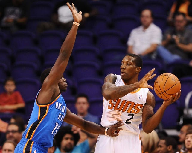 Oct 22, 2013; Phoenix, AZ, USA;Phoenix Suns guard Eric Bledsoe (2) handles the ball against the Oklahoma City Thunder guard Reggie Jackson (15) in the first half at US Airways Center. Mandatory Credit: Jennifer Stewart-USA TODAY Sports