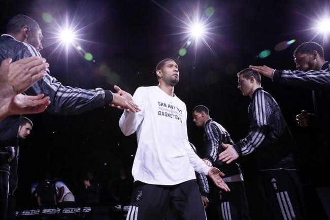 Oct 22, 2013; San Antonio, TX, USA; San Antonio Spurs forward Tim Duncan (21) is introduced prior to a preseason game against the Orlando Magic at AT&T Center. Mandatory Credit: Soobum Im-USA TODAY Sports