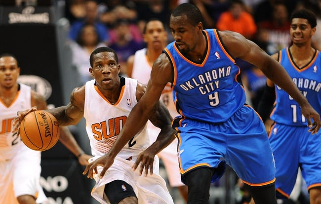 Oct 22, 2013; Phoenix, AZ, USA;Phoenix Suns guard Eric Bledsoe (2) handles the ball against defender Oklahoma City Thunder forward Serge Ibaka (9) in the first half at US Airways Center. The Suns defeated the Thunder 88 to 76. Mandatory Credit: Jennifer Stewart-USA TODAY Sports