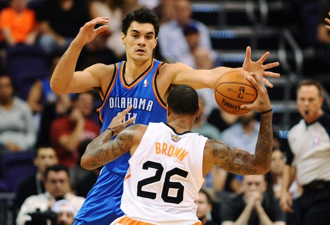 Oct 22, 2013; Phoenix, AZ, USA; Oklahoma City Thunder center Steven Adams (12) defends Phoenix Suns guard Shannon Brown (26) in the first half at US Airways Center. The Suns defeated the Thunder 88 to 76. Mandatory Credit: Jennifer Stewart-USA TODAY Sports