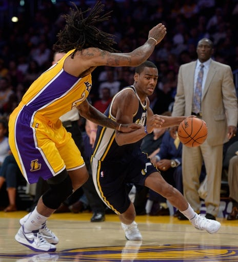 Oct 22, 2013; Los Angeles, CA, USA;  Utah Jazz point guard Alec Burks (10) drives to the hoop on Los Angeles Lakers center Jordan Hill (27) during second half action at Staples Center. Mandatory Credit: Robert Hanashiro-USA TODAY Sports