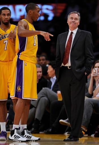 Oct 22, 2013; Los Angeles, CA, USA;  Los Angeles Laker head coach Mike D'Antoni talks to Los Angeles Lakers shooting guard Wesley Johnson (11) during the second half against the Utah Jazz at Staples Center. At left is Los Angeles Lakers shooting guard Xavier Henry (7). Mandatory Credit: Robert Hanashiro-USA TODAY Sports