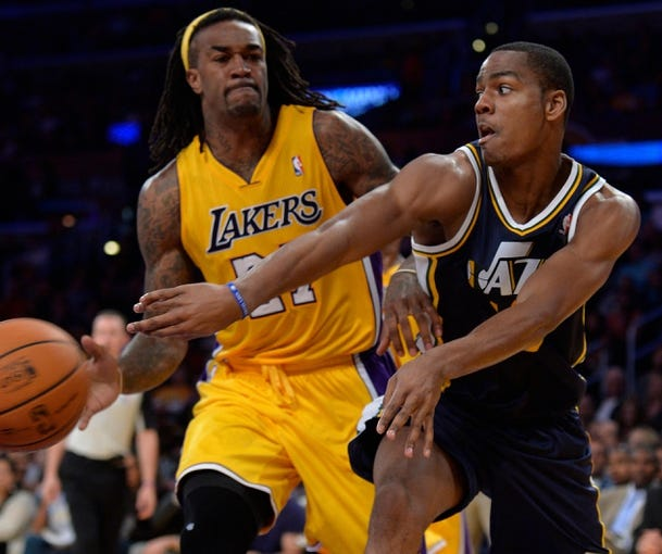 Oct 22, 2013; Los Angeles, CA, USA;  Utah Jazz point guard Alec Burks (10) throws a pass to a teammate past Los Angeles Lakers center Jordan Hill (27) during second half action at Staples Center. Mandatory Credit: Robert Hanashiro-USA TODAY Sports