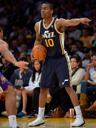 Oct 22, 2013; Los Angeles, CA, USA;  Utah Jazz point guard Alec Burks (10) points to a teammate during second half action against the Los Angeles Lakers at Staples Center. Mandatory Credit: Robert Hanashiro-USA TODAY Sports