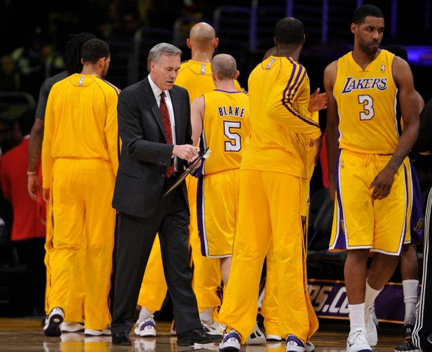 Oct 22, 2013; Los Angeles, CA, USA;  Los Angeles Laker head coach Mike D'Antoni after he talks to his team before tipoff against the Utah Jazz at Staples Center. Mandatory Credit: Robert Hanashiro-USA TODAY Sports