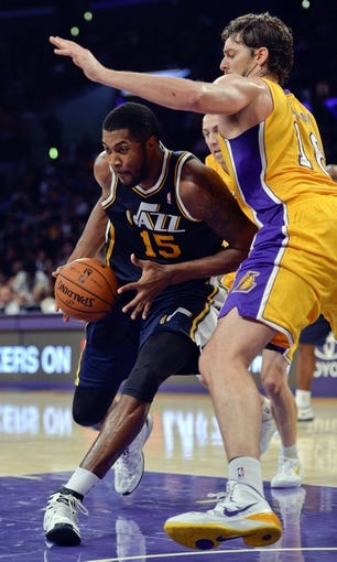 Oct 22, 2013; Los Angeles, CA, USA;  Utah Jazz power forward Derrick Favors (15) drives to the hoop on Los Angeles Lakers power forward Pau Gasol (16) during third quarter action at Staples Center. Mandatory Credit: Robert Hanashiro-USA TODAY Sports