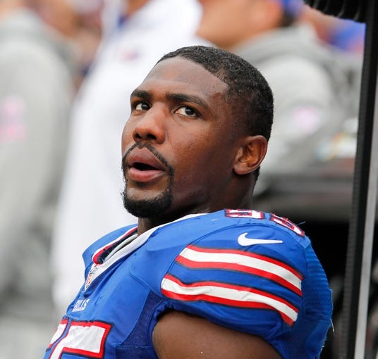 Oct 13, 2013; Orchard Park, NY, USA; Buffalo Bills outside linebacker Jerry Hughes (55) against the Cincinnati Bengals at Ralph Wilson Stadium. Bengals beat the Bills 27 to 24 in overtime.  Mandatory Credit: Timothy T. Ludwig-USA TODAY Sports