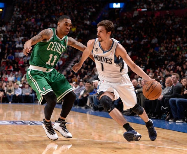 Oct 20, 2013; Montreal, Quebec, CAN; Boston Celtics guard Courtney Lee (11) defends against Minnesota Timberwolves guard Alexey Shved (1) during the first second quarter at the Bell Centre. Mandatory Credit: Eric Bolte-USA TODAY Sports