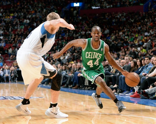 Oct 20, 2013; Montreal, Quebec, CAN; Boston Celtics guard Kammron Taylor (44) goes by Minnesota Timberwolves forward Robbie Hummel (6) during the third quarter at the Bell Centre. Mandatory Credit: Eric Bolte-USA TODAY Sports