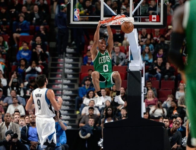 Oct 20, 2013; Montreal, Quebec, CAN; Boston Celtics guard Avery Bradley (0) dunks over Minnesota Timberwolves guard Ricky Rubio (9) during the first quarter at the Bell Centre. Mandatory Credit: Eric Bolte-USA TODAY Sports