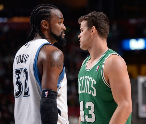 Oct 20, 2013; Montreal, Quebec, CAN; Minnesota Timberwolves center Ronny Turiaf (32) and Boston Celtics forward Kris Humphries (43) during the third quarter at the Bell Centre. Mandatory Credit: Eric Bolte-USA TODAY Sports