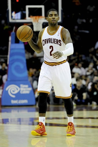 Oct 19, 2013; Cleveland, OH, USA; Cleveland Cavaliers guard Kyrie Irving (2) during the game against the Indiana Pacers at Quicken Loans Arena. Mandatory Credit: Ken Blaze-USA TODAY Sports