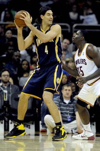 Oct 19, 2013; Cleveland, OH, USA; Indiana Pacers forward Luis Scola (4) and Cleveland Cavaliers forward Anthony Bennett (15) during the game at Quicken Loans Arena. The Pacers beat the Cavaliers 102-79. Mandatory Credit: Ken Blaze-USA TODAY Sports
