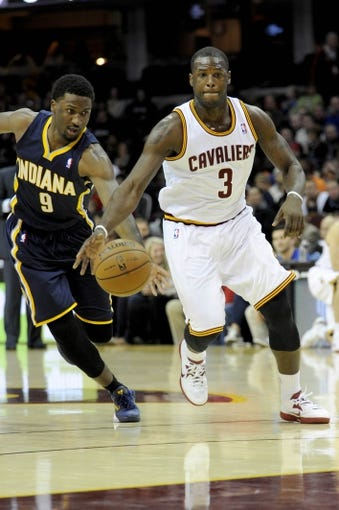 Oct 19, 2013; Cleveland, OH, USA; Indiana Pacers forward Solomon Hill (9) and Cleveland Cavaliers guard Dion Waiters (3) during the game at Quicken Loans Arena. Mandatory Credit: Ken Blaze-USA TODAY Sports