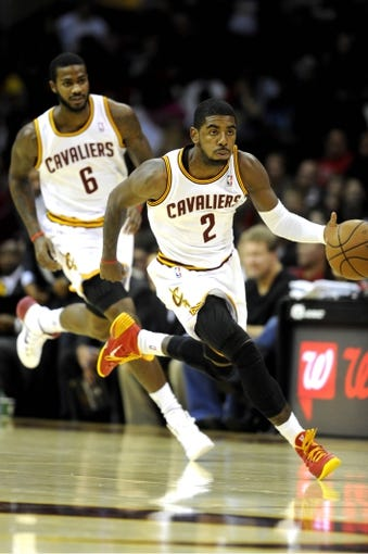 Oct 19, 2013; Cleveland, OH, USA; Cleveland Cavaliers guard Kyrie Irving (2) and Cleveland Cavaliers forward Earl Clark (6) during the game against the Indiana Pacers at Quicken Loans Arena. The Pacers beat the Cavaliers 102-79. Mandatory Credit: Ken Blaze-USA TODAY Sports