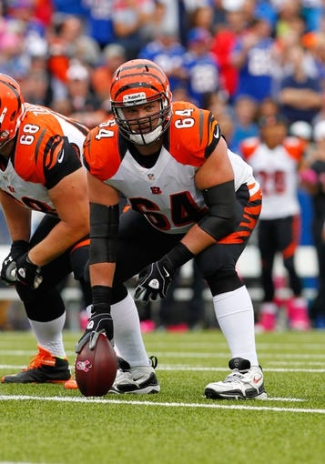 Oct 13, 2013; Orchard Park, NY, USA; Cincinnati Bengals center Kyle Cook (64) waits to snap the ball against the Buffalo Bills at Ralph Wilson Stadium. Mandatory Credit: Timothy T. Ludwig-USA TODAY Sports