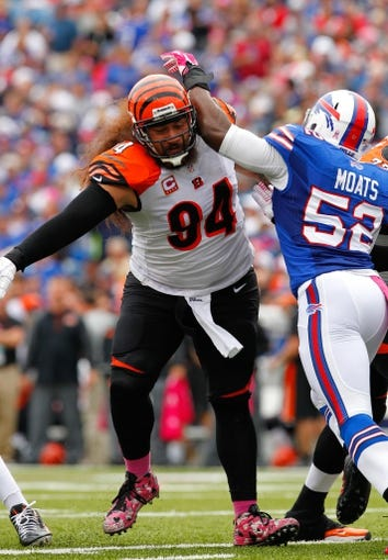 Oct 13, 2013; Orchard Park, NY, USA; Cincinnati Bengals defensive tackle Domata Peko (94) against the Buffalo Bills at Ralph Wilson Stadium. Bengals beat the Bills 27 to 24 in overtime.  Mandatory Credit: Timothy T. Ludwig-USA TODAY Sports
