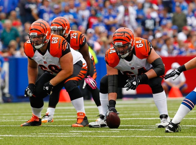 Oct 13, 2013; Orchard Park, NY, USA; Cincinnati Bengals guard Kevin Zeitler (68) and center Kyle Cook (64) against the Buffalo Bills at Ralph Wilson Stadium. Mandatory Credit: Timothy T. Ludwig-USA TODAY Sports