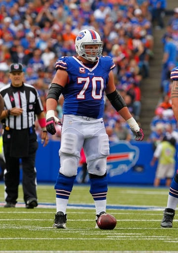 Oct 13, 2013; Orchard Park, NY, USA; Buffalo Bills center Eric Wood (70) against the Cincinnati Bengals at Ralph Wilson Stadium. Bengals beat the Bills 27 to 24 in overtime.  Mandatory Credit: Timothy T. Ludwig-USA TODAY Sports