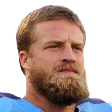 Aug 24, 2013; Nashville, TN, USA; Tennessee Titans quarterback Ryan Fitzpatrick (4) enters the field before a game against the Atlanta Falcons at LP Field. The Titans beat the Falcons 27-16. Mandatory Credit: Don McPeak-USA TODAY Sports