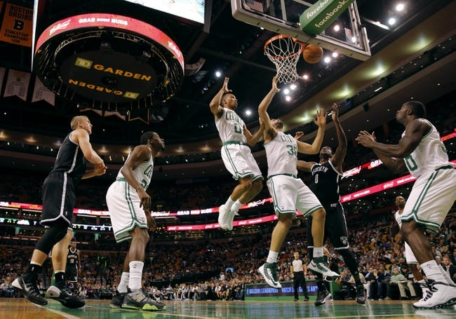 Oct 23, 2013; Boston, MA, USA; Boston Celtics center Vitor Faverani (38) and point guard Avery Bradley (0) play for the rebound against Brooklyn Nets power forward Andray Blatche (0) during the first quarter at TD Garden. Mandatory Credit: David Butler II-USA TODAY Sports