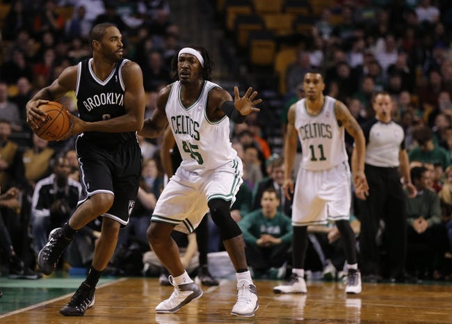 Oct 23, 2013; Boston, MA, USA; Brooklyn Nets shooting guard Alan Anderson (6) looks to pass against Boston Celtics small forward Gerald Wallace (45) during the second quarter at TD Garden. Mandatory Credit: David Butler II-USA TODAY Sports