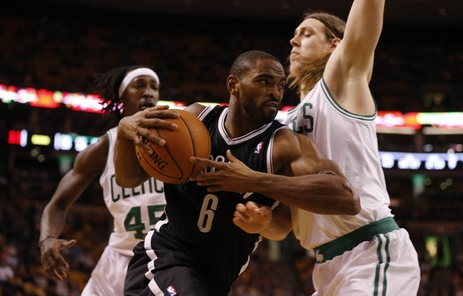 Oct 23, 2013; Boston, MA, USA; Brooklyn Nets shooting guard Alan Anderson (6) drives the ball against `c42` and small forward Gerald Wallace (45) during the second quarter at TD Garden. Mandatory Credit: David Butler II-USA TODAY Sports