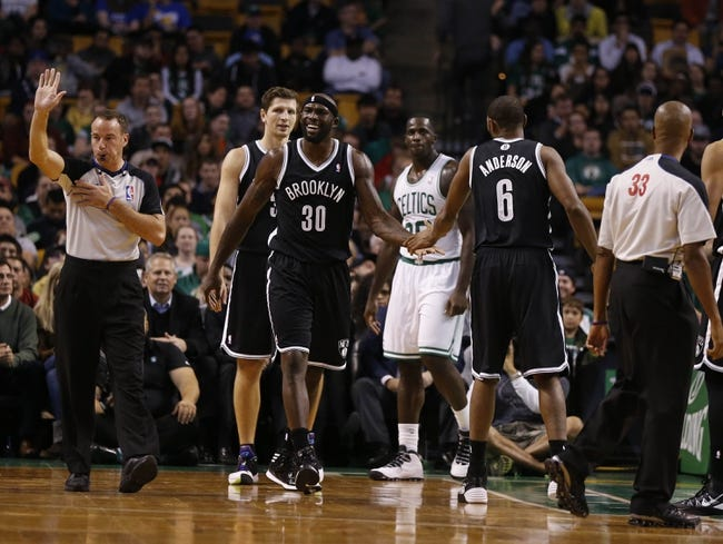 Oct 23, 2013; Boston, MA, USA; Brooklyn Nets power forward Reggie Evans (30) reacts after a foul called against the Boston Celtics during the second quarter at TD Garden. Mandatory Credit: David Butler II-USA TODAY Sports