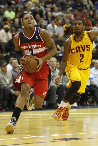Oct 23, 2013; Cincinnati, OH, USA; Washington Wizards guard Bradley Beal (3) moves to the basket against Cleveland Cavaliers guard Kyrie Irving (2) during the first half at US Bank Arena. Mandatory Credit: David Kohl-USA TODAY Sports