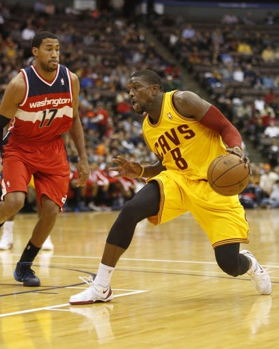 Oct 23, 2013; Cincinnati, OH, USA; Cleveland Cavaliers guard Jermaine Taylor (8) moves against Washington Wizards  guard Garrett Temple (17) during the first half at US Bank Arena. Mandatory Credit: David Kohl-USA TODAY Sports